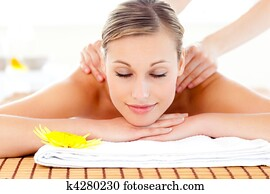 Portrait of a delighted woman lying on a massage table