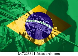 Soldier with machine gun with national flag of Brasil