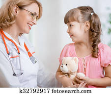 Pediatrician doctor talking with kid