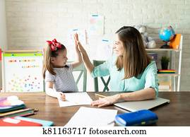 Mom and girl enjoying homeschool together