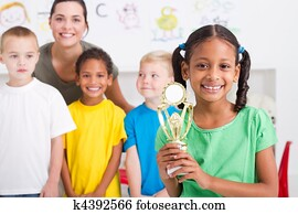 african american girl with trophy