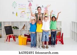 cheerful preschool kids and teacher