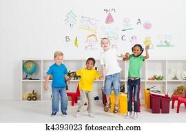 cheerful preschool kids jumping