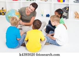 preschool teacher teaching kids