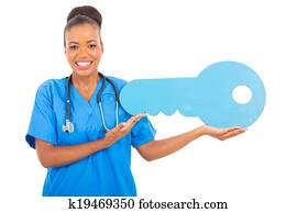 african medical intern doctor holding a toy key