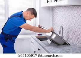 Handyman Fixing Kitchen Sink