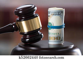 Close-up Of Gavel And Banknote
