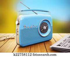 Old radio on wooden table outdoors