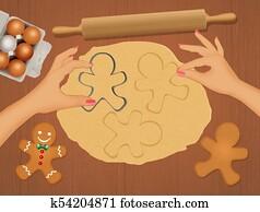 view of woman preparing gingerbread cookies