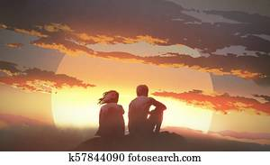 young couple looking at the sunset
