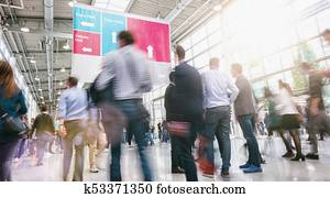 crowd of business people walking at a trade fair