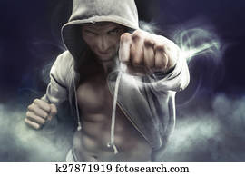 Hooded boxer punching an enemy