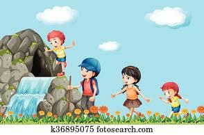Kids hiking on the waterfall
