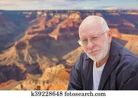 Happy Senior Man Posing on Edge of The Grand Canyon