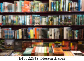 Bookstore blur background with miscellaneous books shelf