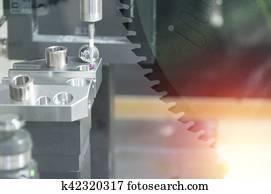 Closeup the Coordinate Measuring Machine (CMM) while measure the