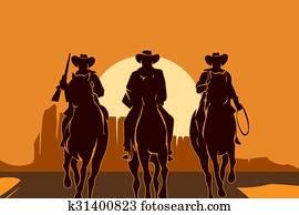 Cowboys riding horses in desert
