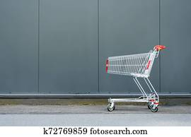 Shopping and buying concept. Purchases Shopping addiction, shopping lover. Conceptual. Selling, buying. Super market, shopping mall background. Wholesale and retail. Shopping cart list.