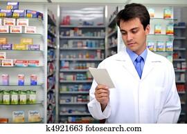 pharmacist reading prescription at pharmacy