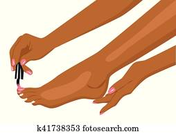 african american woman applying nail polish on her toes