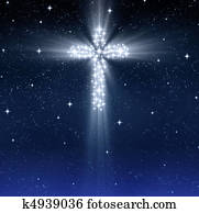 glowing religious cross in stars