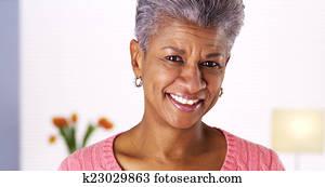 Mature black woman laughing