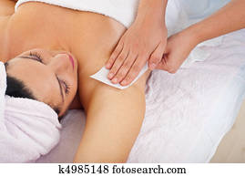 Waxing woman armpit