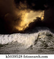Big wave in a stormy sunset