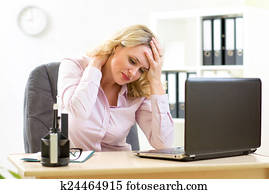 business woman with headache having stress in the office