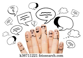 close up of hands and fingers with smiley faces