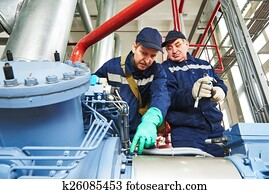 service workers at industrial compressor station