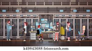 People Working In Data Center Room Hosting Server Computer Monitoring Information Database