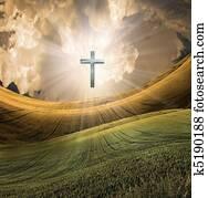 Cross radiates light in sky