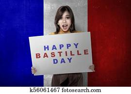 Attractive asian woman with board with Bastille day message
