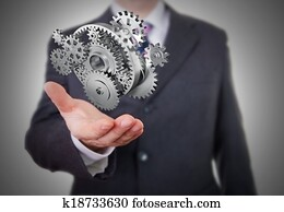 Businessman showing gears