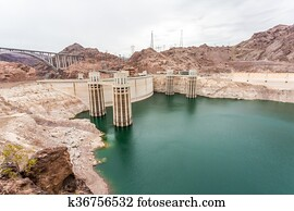 Evening view of Hoover Dam, a concrete arch-gravity dam in the