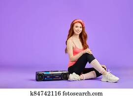beautiful ginger girl with glowing skin relaxing after aerobics