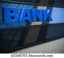 3D bank sign on a facade