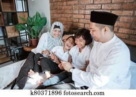 family on ramadan kareem using tablet