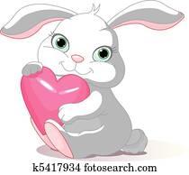 Rabbit holds love heart