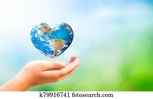 Earth Day concept: hand hold Earth in Heart shape on Natural background, Elements of this image furnished by NASA