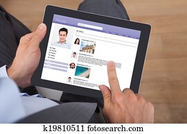 Businessman Surfing Social Networking Site On Digital Tablet