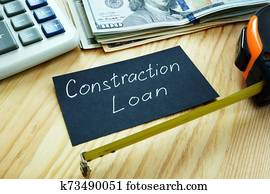 Construction loan concept. Measuring tape and money.