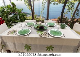 Tasteful and sophisticated prepared table awaits the arrival of guests
