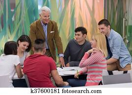 teacher with a group of students in classroom