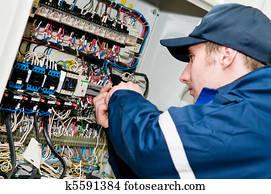 Electrician at voltage adjusting work