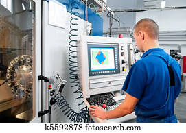 worker operating CNC machine center