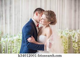 bride groom studio hugs