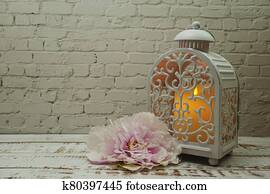 White metal lantern with Candle light Decoration on white brick wall background