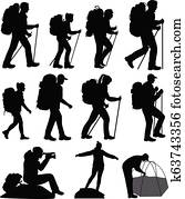 Silhouettes of hiking people
